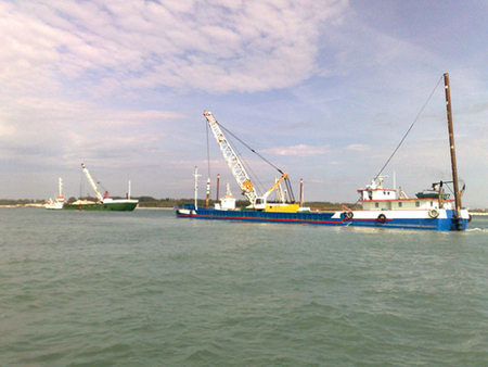 View of the motorboat Nicola Z in the various stages of excavation for Mose